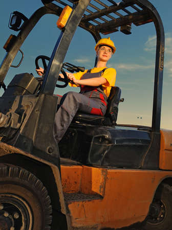 loaders: Female worker driving cargo truck