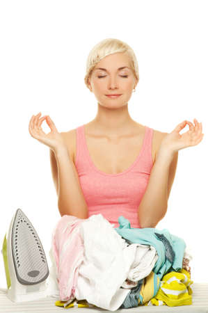 Beautiful young woman meditating before ironing Stock Photo - 5027176