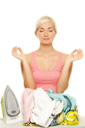 Beautiful young woman meditating before ironing Stock Photo - 5027176