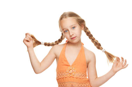 Little girl with side braids. Isolated on white background photo