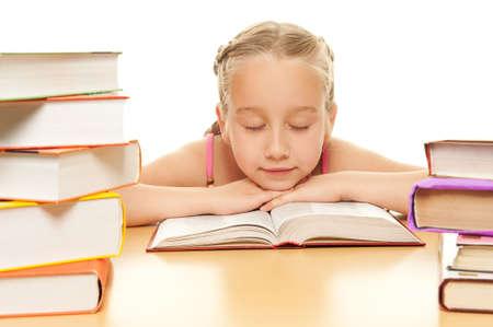 Little schoolgirl fall asleep after reading a book photo