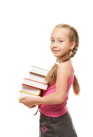 Happy litthe schoolgirl with a stack of heavy books Stock Photo - 5057351