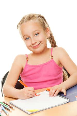 Happy schoolgirl drawing photo