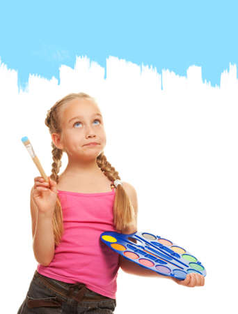 Beautiful little girl painting with blue paint photo