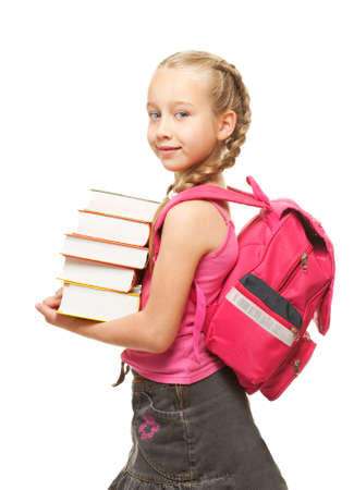 Happy little schoolgirl with a stack of heavy books Stock Photo - 5091805