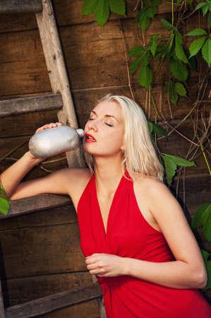 Beautiful woman drinking water outdoor photo