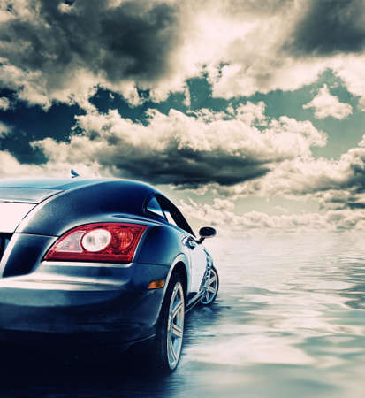 exhaust: Sport car reflected in water     Stock Photo