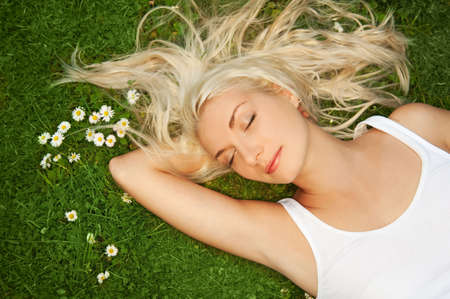 Young woman relaxing on a meadow     photo