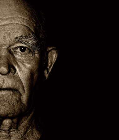 Elderly man's face over blask background Stock Photo - 5209355