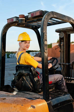 Female worker driving cargo truck     photo