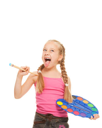 girl tongue: Beautiful little girl with a paintbrush, Isolated on white     Stock Photo