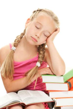 sleeping kid: Little schoolgirl fall asleep after reading a book