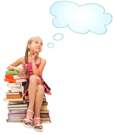 bambini pensierosi: Little schoolgirl seduto su una pila di libri