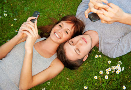 Young couple with mobile phones outdoor  Stock Photo - 5219434
