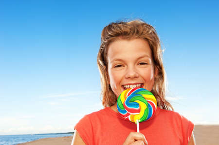 Happy girl with sweet candy photo