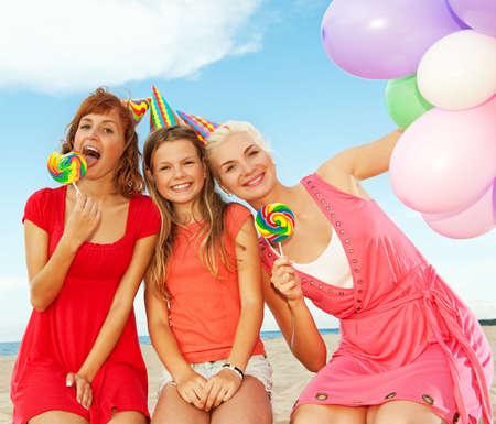 Happy friends on the beach Stock Photo - 5258323