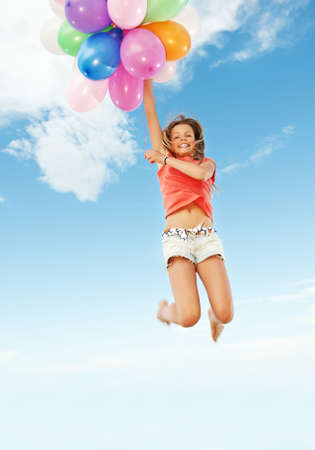 Happy girl with colorful balloons photo