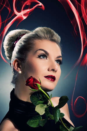 Charming lady with red rose Stock Photo - 5281797
