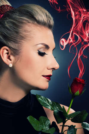 Charming lady with red rose Stock Photo - 5281805