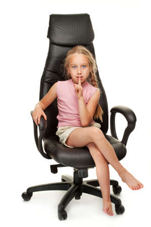 little girl sitting: Young girl sitting on a chair