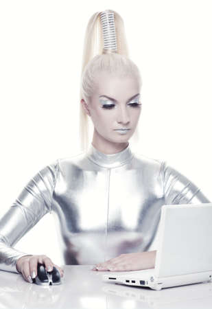 futuristic girl: Beautiful cyber woman working on her laptop