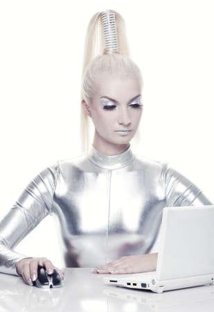 cyber girl: Beautiful cyber woman working on her laptop