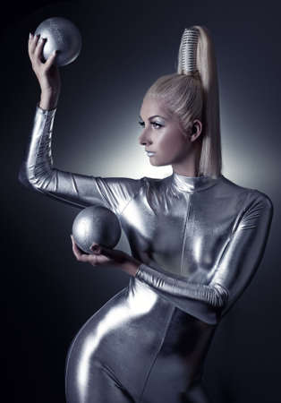 latex: Beautiful cyber woman with silver balls