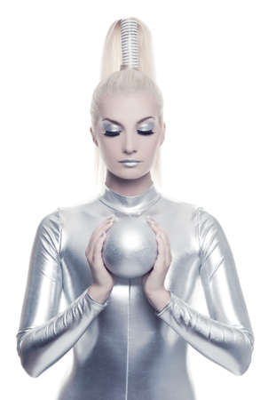 futuristic woman: Beautiful cyber woman with silver ball Stock Photo