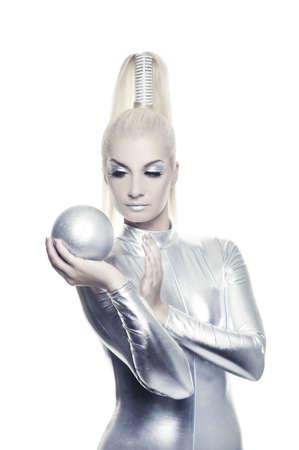 latex girl: Beautiful cyber woman with silver ball Stock Photo