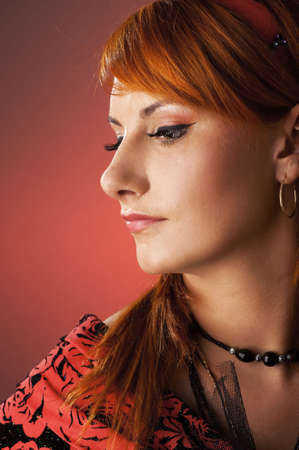 Redhead woman retro close-up portrait photo