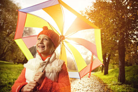 Beautiful little girl with colorful umbrella     photo