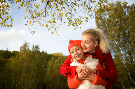 Mother and daughter outdoors     photo