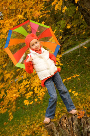 Beautiful little girl with umbrella outdoors     photo