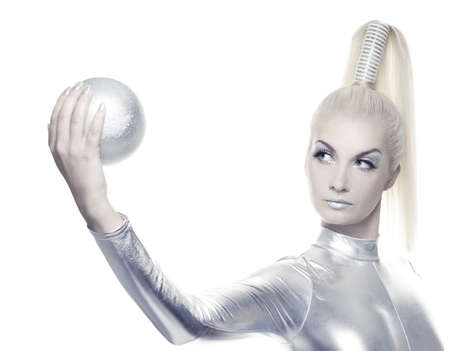 robot girl: Beautiful cyber woman with silver ball     Stock Photo