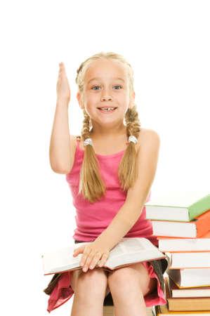 answer question: Little studentessa alz� la mano per rispondere a domande Archivio Fotografico