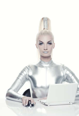 Beautiful cyber woman working on her laptop     photo