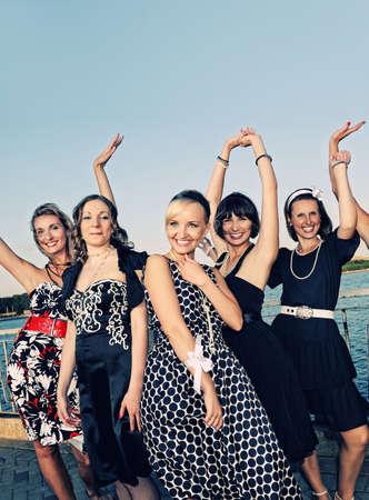 outdoor glamour: Happy women retro group portrait