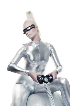 cyber woman: Beautiful cyber woman playing video game Stock Photo