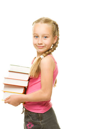 Happy little schoolgirl with a stack of heavy books   Stock Photo - 5405578
