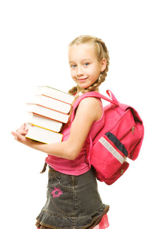 Happy little schoolgirl with a stack of heavy books Stock Photo - 5405588