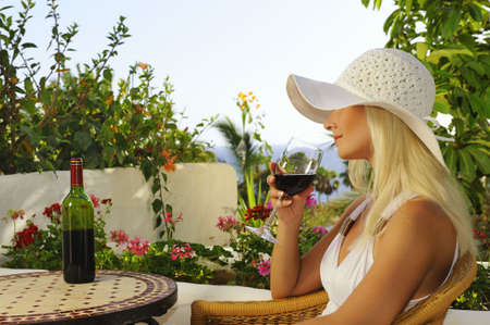 Beautiful woman with a glass of wine photo