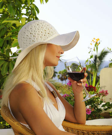 hotel balcony: Beautiful woman with a glass of wine Stock Photo