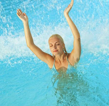 Beautiful woman relaxing in the pool photo