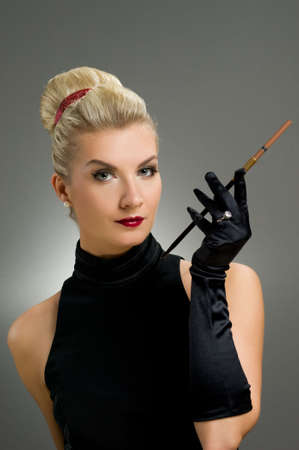 Charming lady smoking cigarette      photo