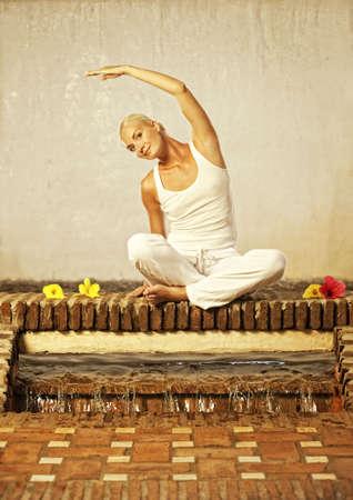 Beautiful young woman doing yoga exercise photo