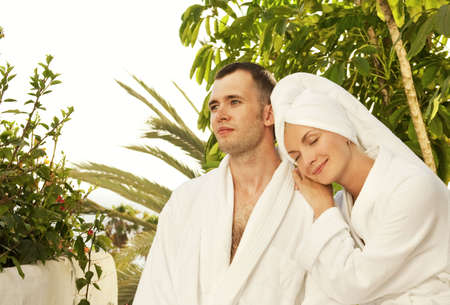 Young couple relaxing after bath photo