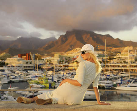 wealthy lifestyle: Attractive young woman near the yachts Stock Photo