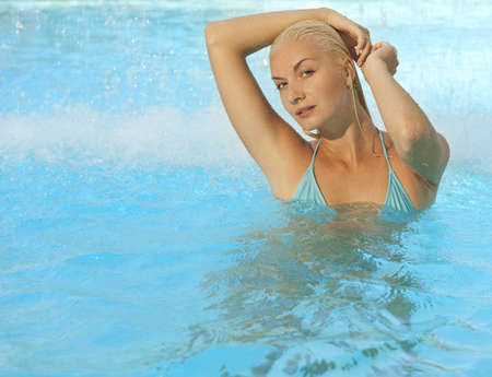 Beautiful woman relaxing in the pool photo