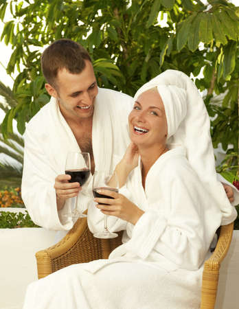 Happy couple with a glasses of wine outdoors photo