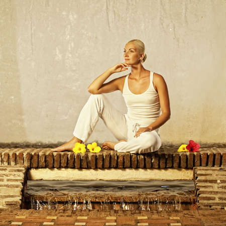 Beautiful young woman relaxing after yoga photo